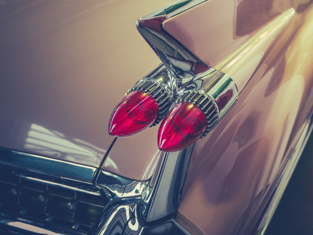 Retro Filtered Image Of The Tailfin Of A Classic Vintage American Car