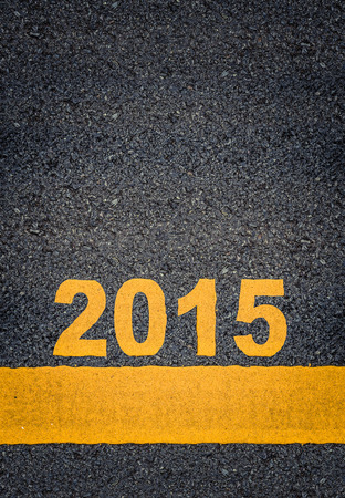 single line: Conceptual Image Of Year 2015 As Yellow Asphalt Road Markings With Single Line And Copy Space Stock Photo