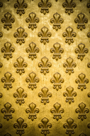 regal: Background Texture Of A Regal, Gold Fleur-de-lis Coat-Of-Arms On Napoleons Tomb In Paris, France Stock Photo