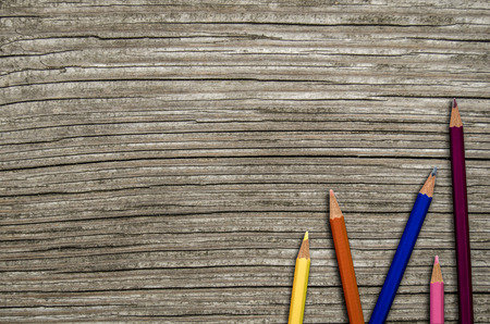 old pencil: Back To School Image Of Some Colored Pencils On A Rustic Wooden Desk