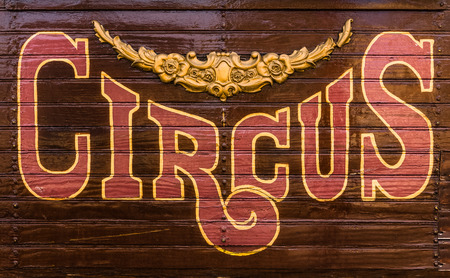 circus animal: Retro Style Rustic Circus Sign On The Side Of A Caravan Or Wagon