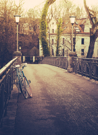 Retro filtered bicycles on a bridge in winter in a European city photo