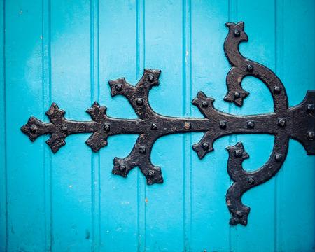 hinge: Vintage Ornate HInge On A Bright Blue Painted Church Door