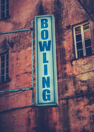 drab: Grungy Retro Sign For A Bowling Alley Stock Photo