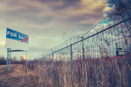 A For Sale Billboard Sign In An Urban Industrial Wasteland Or Vacant Lot
