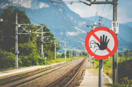 hand stop: A Warning Sign At A Train Station In The Alps In Austria