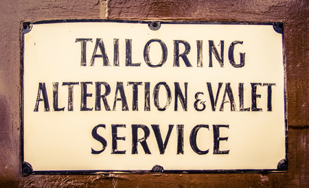 tailor suit: A Vintage Sign For A Tailor And Valet In London England