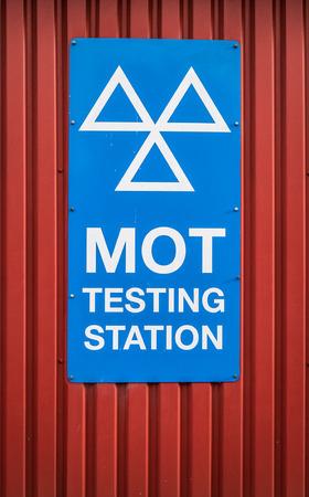 A Motor Ordinance Test (MOT) Station Sign At A Garage In The UK 스톡 콘텐츠