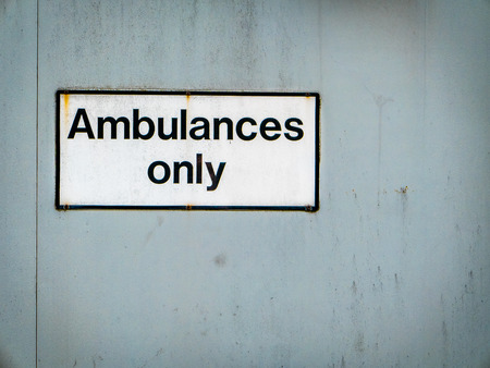 only: A Grungy Ambulances Only Sign At A Hospital Emergency Room