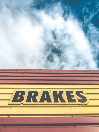 gaudy: An Auto Repair Shop Or Garage With Gaudy Brakes Sign