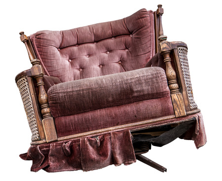 An Isolated Old Damaged Vintage Purple Armchair
