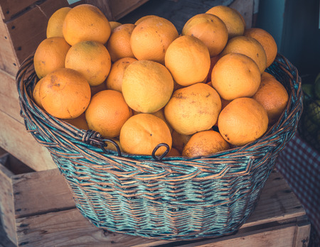 health food store: Rustic Basket Of Organic Oranges At A Health Food Store