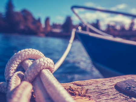 ropes: Retro Filtered Photo Of A Luxury Yacht Tied To Pier Stock Photo