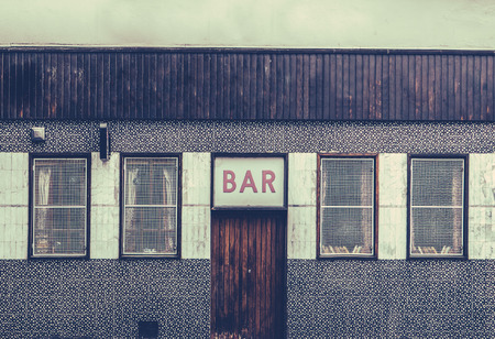 sordid: Retro Filtered Image Of A Grungy And Seedy Bar