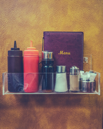Retro Hipster Diner Or Dafe Menu And Condiments Against Faux Leather Backdrop Stock Photo