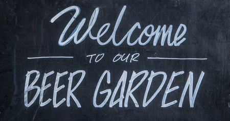 microbrewery: A Blackboard Sign Outside A Bar Or Pub Saying Welcome To Our Beer Garden Stock Photo