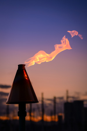 torches: Retro Style Image Of A Hawaiian Tiki Torch By The Coast In Honolulu At Sunset