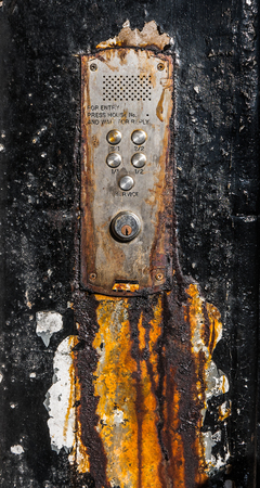 intercom: A Rusty Old Buzzer Or Intercom System For Flats In Glasgow, Scotland Stock Photo