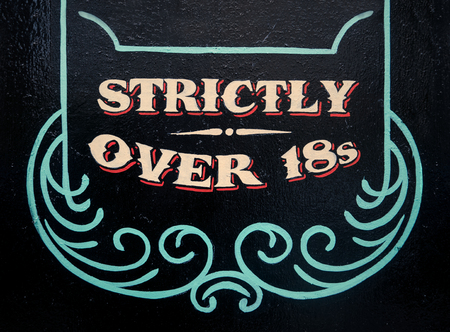 A Sign On A Wall Saying Strickly Over 18s