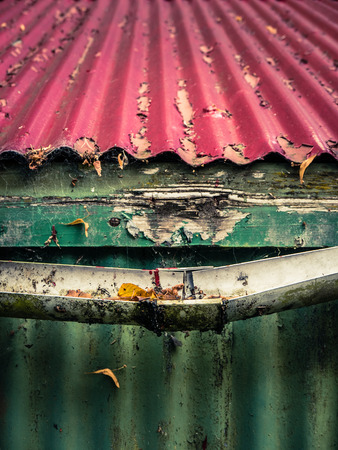 metal working: Broken Plastic Gutter On The Roof Of A House Or Farm Building