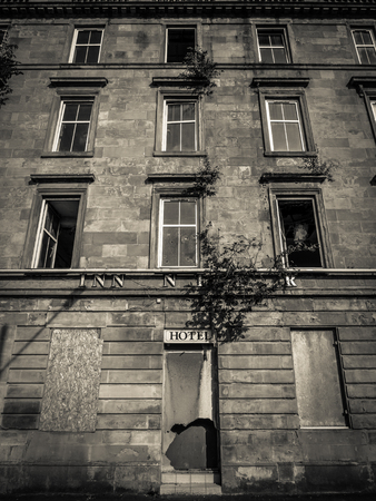 boarded: Black And White Image Of A Derelict And Boarded Up Hotel Stock Photo