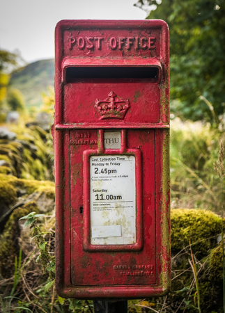post mail: A Vintage British Village Post Or Mail Box