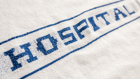 BRANDED: Detail Of A Blue And White Hospital Branded Towel