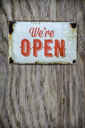 rusty: Rustic Vintage Open Store Sign On A Wooden Door