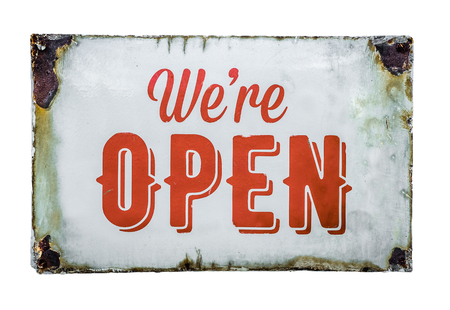 Isolated Vintage Rusty White Metal We're Open Sign