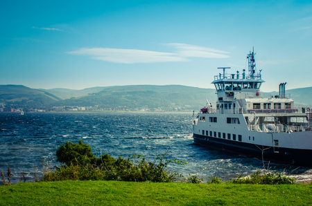 british weather: A Car Ferry Leaving Port  From A The Scottish Island Of Great Cumbrae Stock Photo