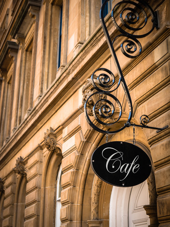 ornate: Ornate Sign For An Exclusive Cafe In A European City
