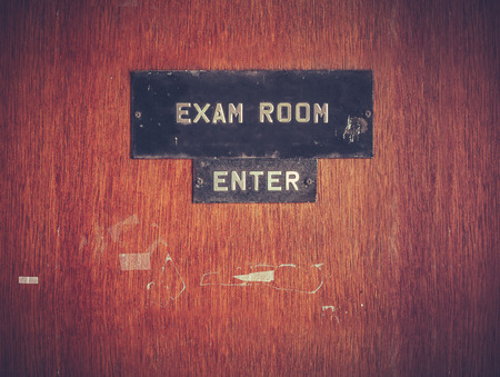 exam room: Retro Filtered Image Of A Grungy Exam Room Door At A Public School In The USA