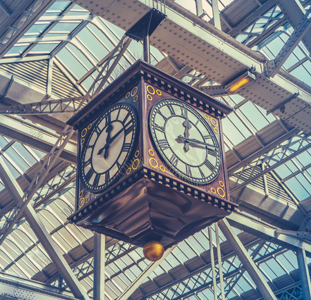 timekeeping: Retro Image Of The Vintage Clock And Meeting Point Under The Glass Roof Of Glasgow Central Station Editorial