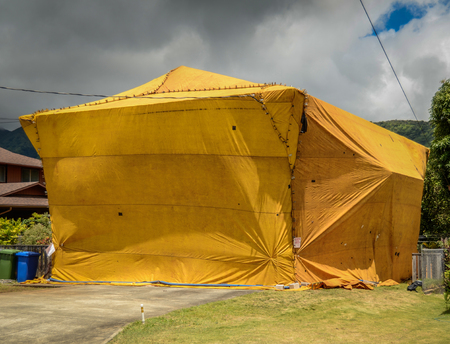 exterminate: Residential House That Has Been Tented To Exterminate Insect Pests Such As Termites
