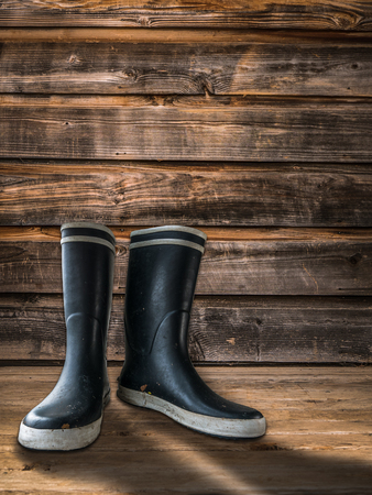 Rubber Boots Or Wellingtons On The Porch Of A Farmhouse Or Homestead