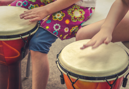 An Action Music Shot Of Children Drumming Stock Photo