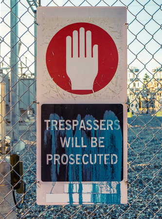 power transformer: Trespassers Will Be Prosecuted Sign Outside An Electrical Power Transformer Substation