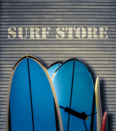 store sign: Retro Filtered Surf Store Sign With Blue Surfboards Stock Photo