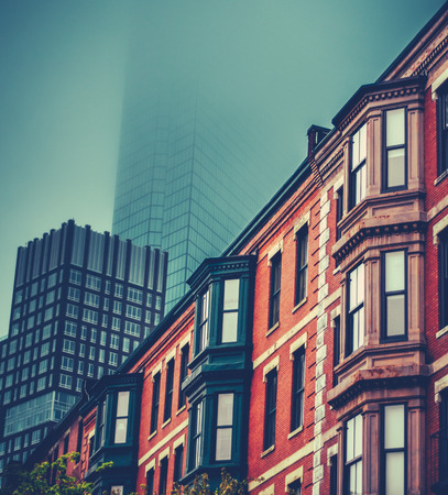 rowhouses: Red Brick Victorian Terrace Houses In Back Bay, Boston Set Against Modern Skyscrapers Stock Photo