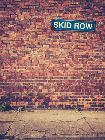 skid: Urban Decay Image Of A Skid Row Sign On A Red Brick Wall