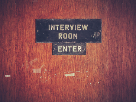 Retro Filtered Image Of A Grungy Interview Room Door Stockfoto