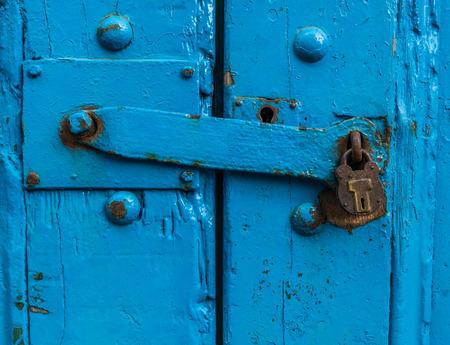 sturdy: Vintage Sturdy Blue Wooden Door With Heavy Metal Lock