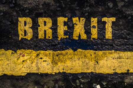 yes or no to euro: Grungy Concept British Road Markings Saying Brexit Stock Photo