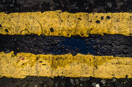 yellow line: Grungy Double Yellow Line Road Markings On A British Street