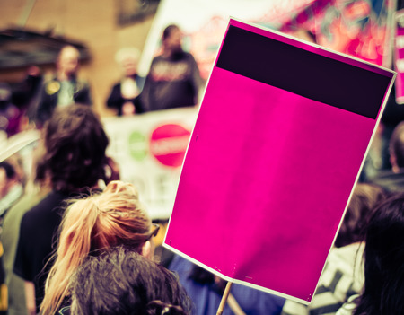Busy Street Protest March With A Blank Sign For Your Text