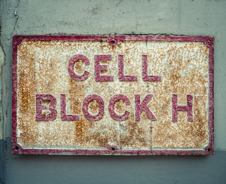 cell block: Grungy Cell Block Sign At A Maximum Security Prison