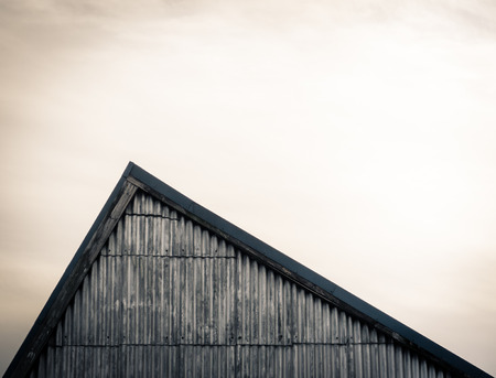 sloping: Minimalist Image Of An Industrial Sloping Factory Roof With Copy Space