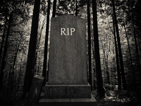 Spooky RIP Gravestone In A Dark Forest Setting Stock Photo