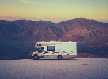Retro RV Camper In The Californian Desert Wilderness At Sunset