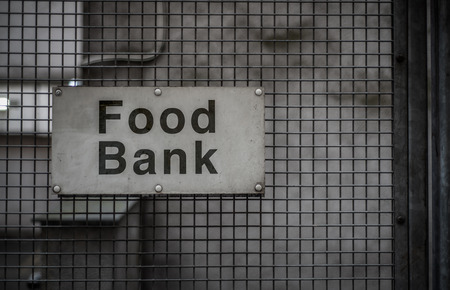A Grungy Sign For A Food Bank In A Backstreet Stock fotó - 103737561